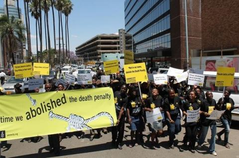 Amnesty activists march through the streets in Harare in Zimbabwe in a peaceful protest on the World Day against the Death Penalty. Photo: Al